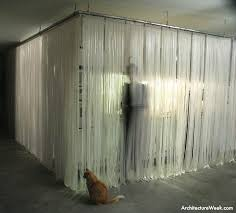 a curtain of translucent plastic strips acts as a mosquito barrier