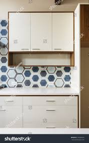 Kitchen Cabinets Trim by White Kitchen Cabinets Wood Trim Hexagonal Stock Photo 168285695