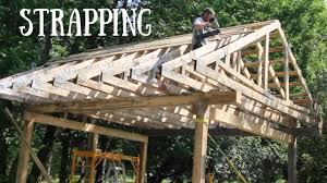 strapping roof on post and beam off grid outdoor kitchen
