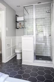 the family bathroom combines grey subway tile on the shower walls