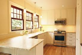 white kitchen cabinets with window trim wood stained windows pendant lighting bright kitchens