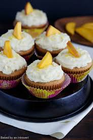 the cupcakes mango cupcakes with mango buttercream baked by an introvert