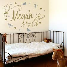 girl s swirly personalised name wall stickers decals metallic gold and silver girl s swirly personalised name behind a girl s