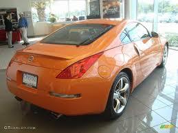 orange nissan 350z 2007 solar orange pearl nissan 350z touring coupe 21309711 photo