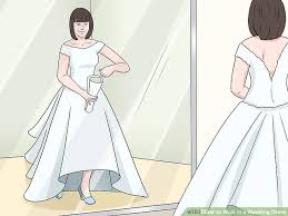 in wedding dress 3 ways to walk in a wedding dress wikihow