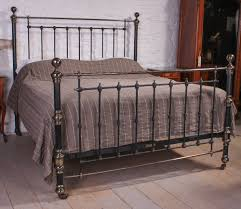 very handsome 6ft super king size victorian black and aged brass