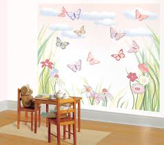 wall theme pink butterfly wall theme added by brown wooden table and chairs