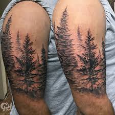 cap1 tattoos tattoos black and gray pine tree forest half