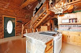 log cabin house kitchen room with rocky cabinet and white stove