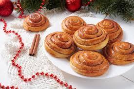 Homemade New Year Decorations by Cinnamon Bun Rolls Homemade Christmas Sweet Dessert On White