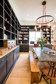relaxed industrial style kitchen and library canterbury north