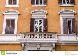balcony with columns and windows with shutters with marble