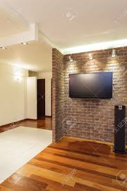 spacious apartment brick wall in spacious modern house stock