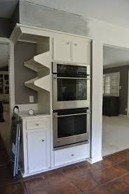 torsion box floating shelves into side of kitchen cabinets