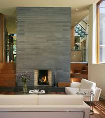 gray brick fireplace living room contemporary with built in stairs