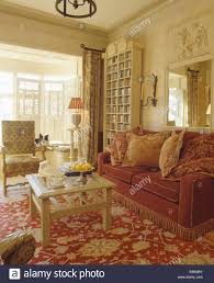 Cream Living Room by Patterned Cushions On Dark Red Sofa With Fringed Edging In Cream