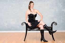 in little black dress with boots stock photo picture and