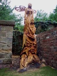 wooden carving in tree stumps wood sculptures of females by