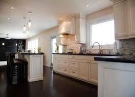 white kitchen cabinets countertops and dark granite countertops