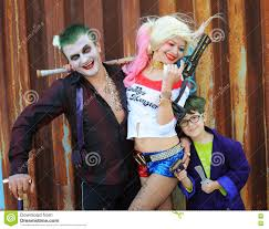 cosplayers in harley quinn costume in joker costumes editorial