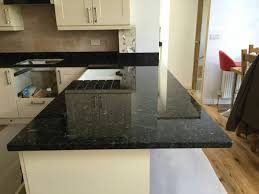 granite countertop 3 inch bronze cabinet pulls grey brick tiles