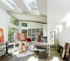 artist studio overlooks guest cabin with rooftop garden