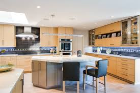 d kitchen plan with teal cabinet and modern pink dining chairs in