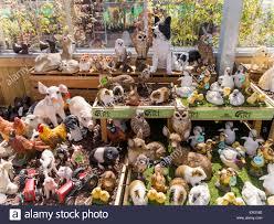 garden centre display of coloured animal garden ornaments stock