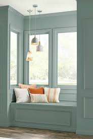 behr in the moment in a reading nook on painted wall panelling