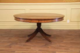 round adams style antique reproduction pedestal dining table
