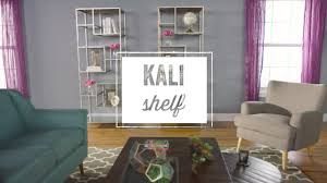 burnished metal and glass asymmetrical kali shelf world market