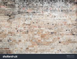 red old weathered exposed brick wall stock photo 583599382
