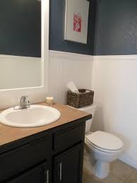 small half bathroom tile ideas features gray stained wall and