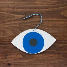 wooden eye ornament device