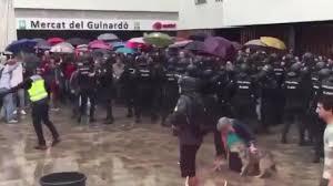 catalonia independence referendum sees police smashing way into