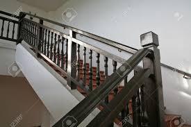 Dark Wood Banister Wooden Stairways With Dark Wood Railings White Walls Stock Photo