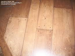 these planks are on a plywood floor with a sharpie
