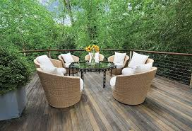 Deck Coffee Table - contemporary deck with wicker furniture by the corcoran group
