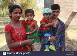 rural tribal family with children gujarat india stock photo