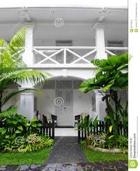 tropical antique colonial house with landscaping stock photo