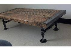 Pipe Coffee Table by This Is A Beautiful Ebony Black Stained Solid Wood Beam And Iron