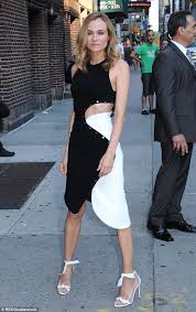 diane kruger flaunts her petite frame in a black and white dress