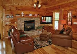 Log Home Pictures Interior Wondrous Brown Leather Sofa With Brick Wall Fireplace Also Ceiling