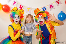 clown show for birthday party clown girl and clown boy at the birthday of a child party for