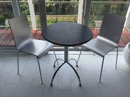 Stainless Steel Bistro Table Black Granite Bistro Table And 2 Stainless Steel Chairs In