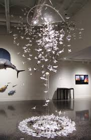 this origami crane sculpture is inspiring a scene in complicated