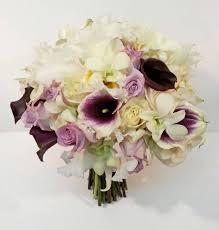 wedding flowers calgary purple ivory cattelya frilly orchid calla bridal wedding