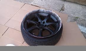 stock wheels painted using plasti dip g35driver infiniti g35