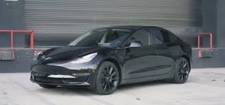 tesla outside tesla model 3 looks badass with aftermarket chrome delete tint