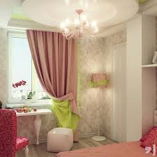 pink bed with white wooden table and square white ottoman also